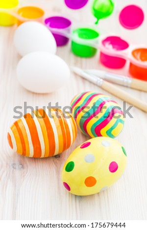 Easter eggs and process of painting eggs. Selective focus - stock photo
