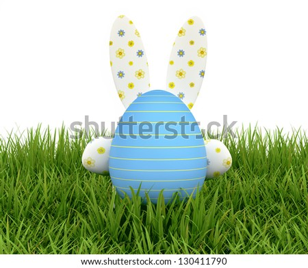 Easter Eggs and rabbit on the grass - stock photo