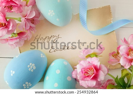 easter eggs and spring flowers frame background - stock photo