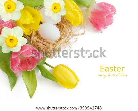 Easter eggs and tulips and narcissus flower bunch isolated on white background - stock photo