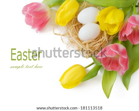 Easter eggs and tulips flower bunch isolated on white background - stock photo