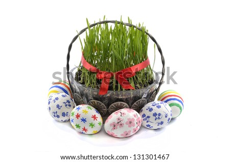 Easter eggs and wheat grass on a plate