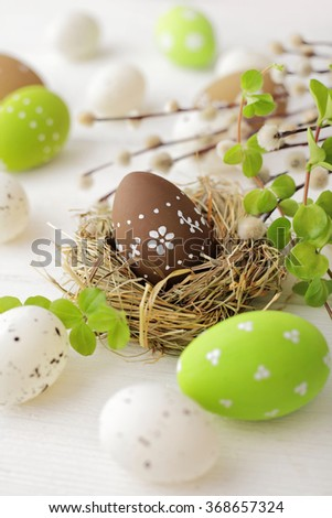 easter eggs and willow branches - stock photo