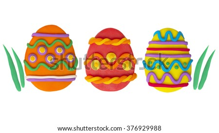 Easter eggs colour plasticine crafts on a white background - stock photo