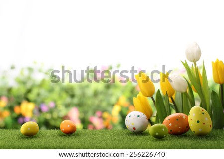 Easter eggs decorated with flowers on meadow - stock photo