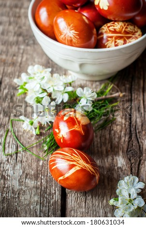 Easter Eggs Decorated with Grasses and Flowers using Peels of Onions - stock photo