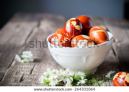 Easter Eggs Decorated with Natural Grass and Flowers and Boiled in Onions Peels, Rural Style - stock photo