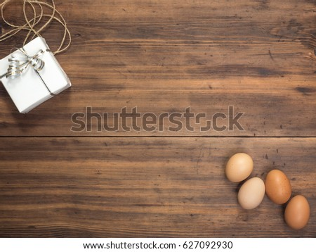 Easter eggs gift box on old stock photo 627092930 shutterstock easter eggs gift box on old wooden table from planks top view with space negle Image collections