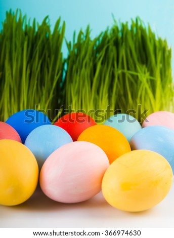 Easter eggs,  green grass as background