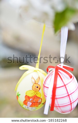 Easter eggs hanging on branch - stock photo