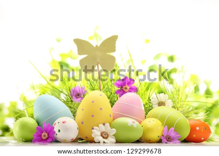 Easter eggs hiding in the grass with flower - stock photo
