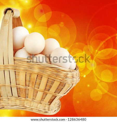 Easter Eggs in a Basket on a Bright Orange Background