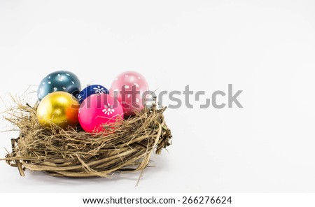 Easter eggs in a nest on a white background. - stock photo