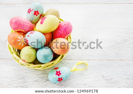 Easter eggs in a wicker basket - stock photo