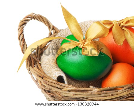 Easter eggs  in basket isolated  on white - stock photo