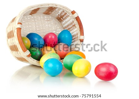 Easter Eggs in basket (isolated on white)