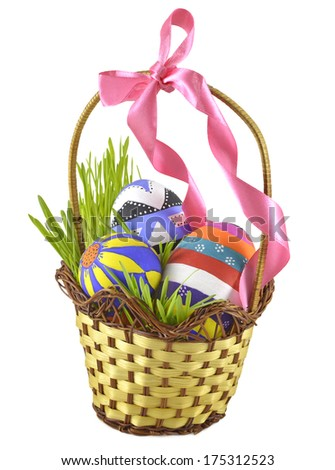 Easter eggs in basket with bow isolated on white