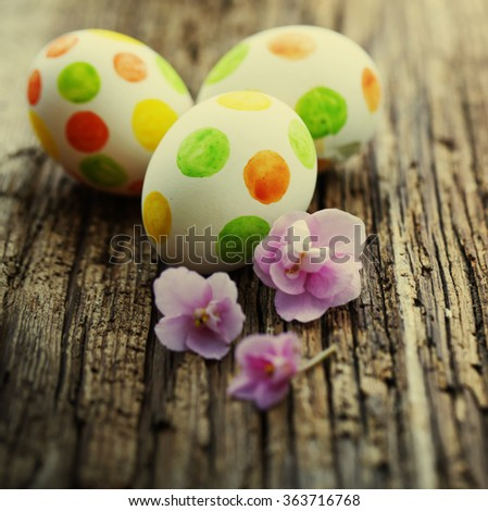 easter eggs in basket with bow on white background - stock photo