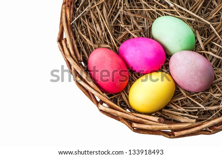 Easter eggs in basket with hay