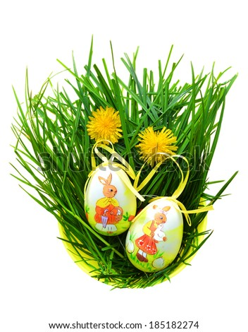 Easter eggs in fresh green grass - isolated on white - stock photo