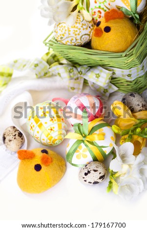 Easter eggs in green basket with chickens - stock photo