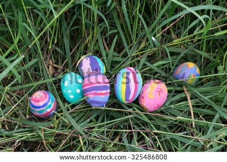 Easter eggs in Green Grass. Selective focus.