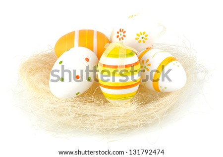 Easter eggs in nest isolated on white background