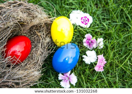 Easter eggs in nest on green grass