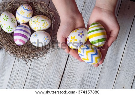 easter eggs in the hands of a child