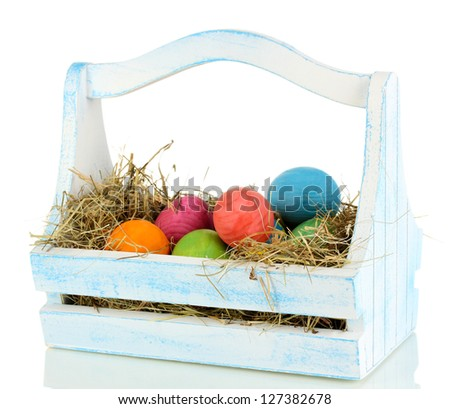 Easter eggs in wooden basket isolated on white - stock photo