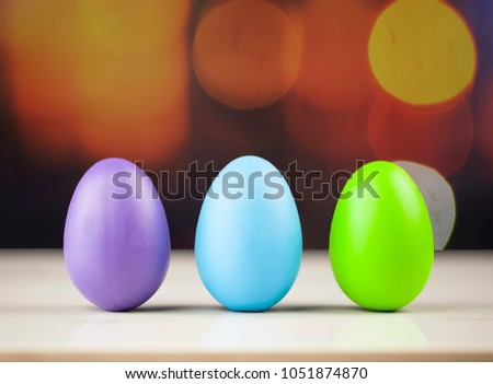 Easter eggs on a blue wooden table.Three colorfull egg.Copy space.Easter background.