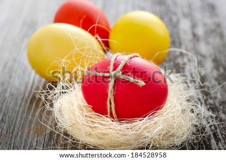 Easter eggs on a old wooden background - stock photo