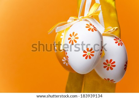 Easter eggs on a orange  background - stock photo