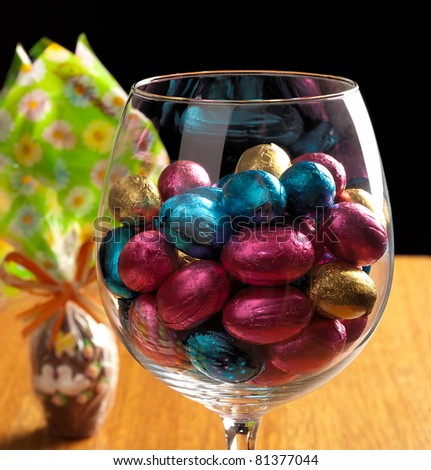 easter eggs on a wooden table with some decoration element - stock photo