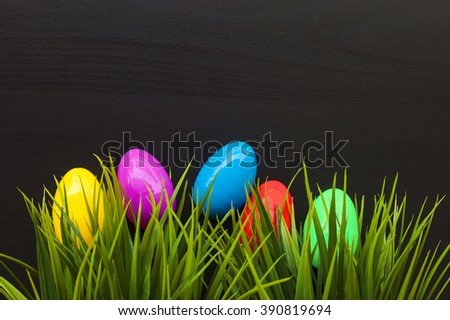 Easter eggs on black wooden background