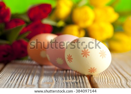 Easter eggs on colorful spring background - stock photo