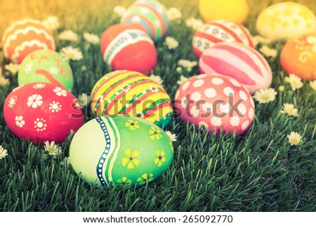 Easter Eggs on Fresh Green Grass ( Filtered image processed vintage effect. ) - stock photo