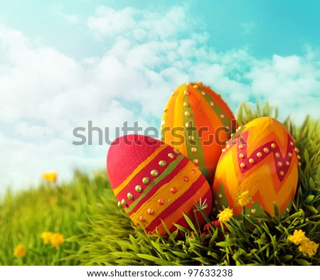 Easter eggs on green grass - stock photo