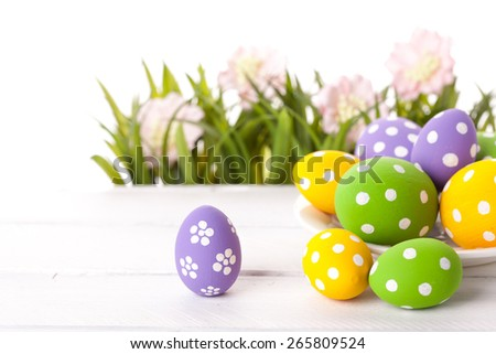 Easter eggs on green grass. Studio shot - stock photo