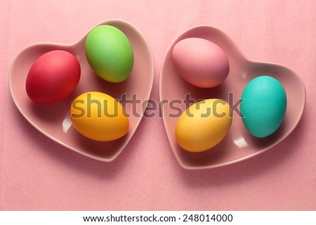 Easter eggs on pink background - stock photo