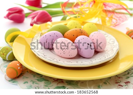 easter eggs on plate and tulips - stock photo