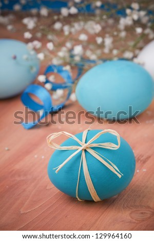 Easter eggs on wooden background - stock photo