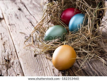 Easter eggs on wooden background, close-up. - stock photo