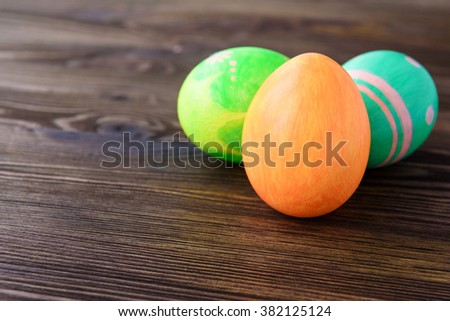 Easter eggs on wooden background, colorful, bright