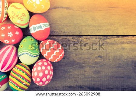 Easter eggs on wooden background ( Filtered image processed vintage effect. ) - stock photo