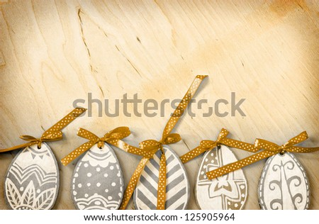Easter eggs on wooden background/ vintage Easter card with  eggs - stock photo