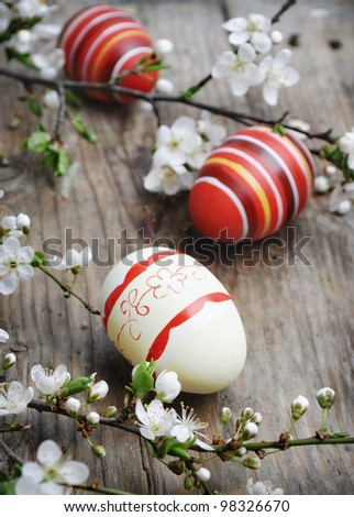 Easter eggs on wooden plank - stock photo
