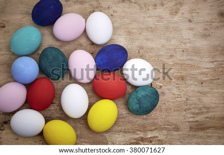 Easter eggs on wooden table, top view