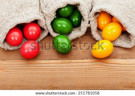 Easter eggs on wooden table - with copy space
