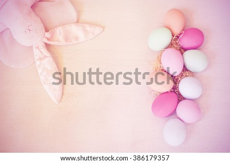 Easter eggs painted in pastel colors and rabbit doll on a white background,pastel tone.